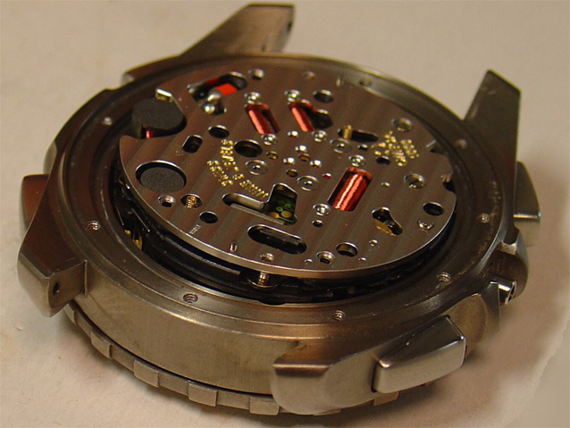 "Cal. 1666 movement partially extracted from the case for better viewing – note the attempt at basic Côtes de Genève (""Geneva stripes"") decoration, seldom seen on quartz movements. Photograph courtesy of Frank_be"
