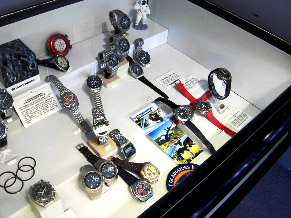 "Omega Speedmaster Display at the Omega Museum in Bienne, Switzerland. The ""crash tested"" X-33 prototype is shown 3rd from right.  Photo courtesy Don Aldo."