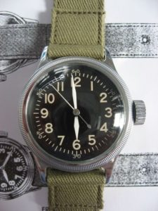WWII-era Elgin 'A-11' US military watch, on which the J. Crew watch was purportedly based but shows few similarities.