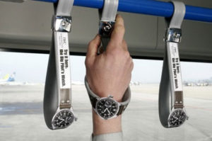 "IWC ""Ambient Advertising"" bus hand straps."