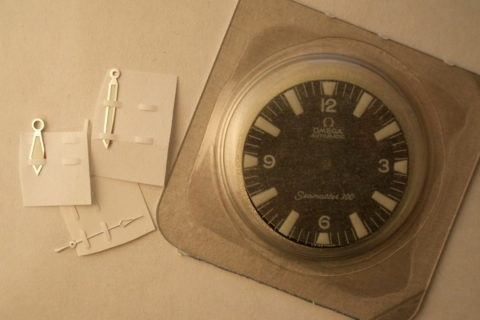 Omega spare parts dial and hands of recent manufacture with modern Luminova